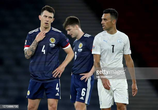 Ryan Jack and Kieran Tierney of Scotland and Eran Zahav of Israel after the UEFA Nations League group stage match between Scotland and Israel at...