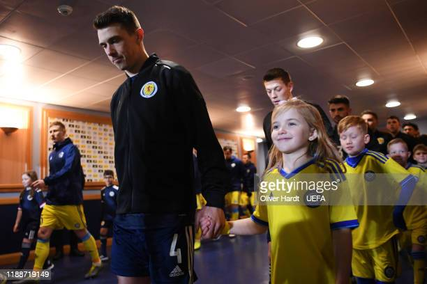 Ryan Jack of Scotland and Player escort kids smile in the tunnel prior to the UEFA Euro 2020 qualifier between Scotland and Kazakhstan at Hampden...