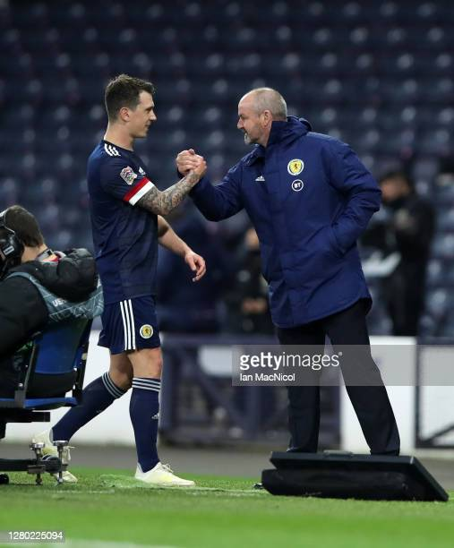 Ryan Jack of Scotland interacts with Steve Clarke Head Coach of Scotland after the UEFA Nations League group stage match between Scotland and Czech...