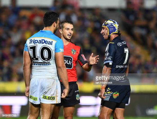 Ryan James of the Titans and Johnathan Thurston of the Cowboys talk to the referee during the round seven NRL match between the North Queensland...