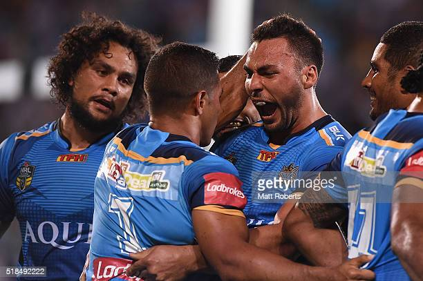 Ryan James of the Titans celebrates with try scorer David Mead during the round five NRL match between the Gold Coast Titans and the Brisbane Broncos...