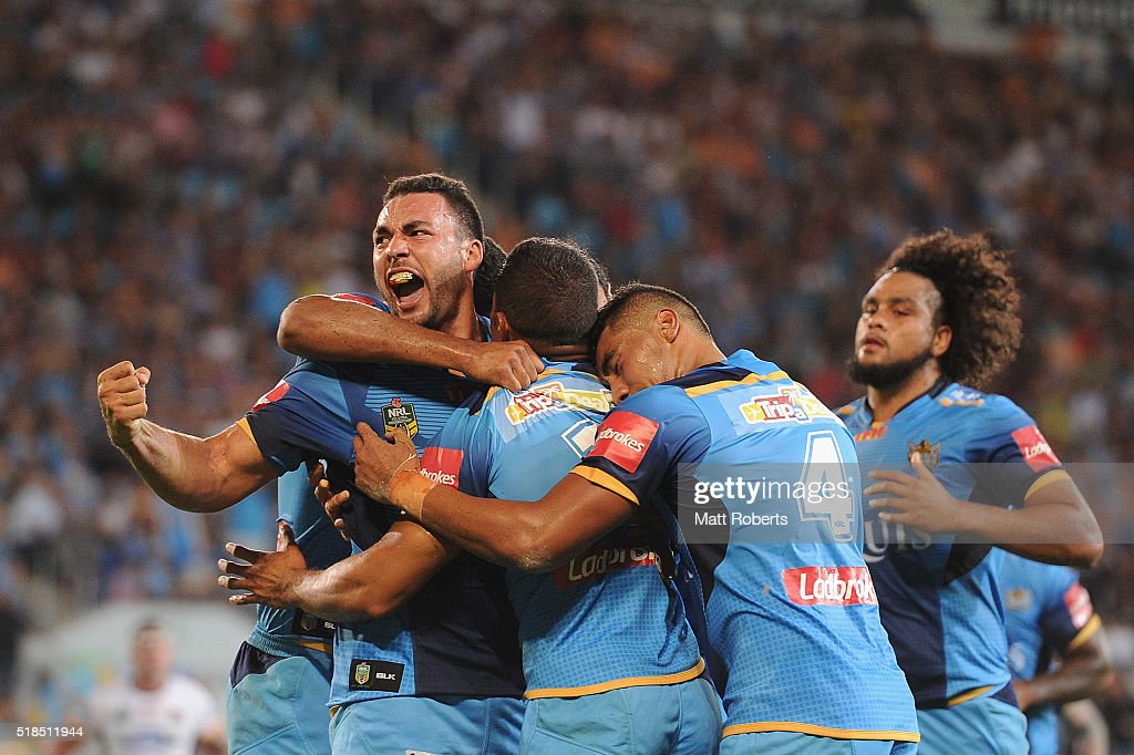 Ryan James of the Titans celebrates with try scorer David Mead during the round five NRL match between the Gold Coast Titans and the Brisbane Broncos at Cbus Super Stadium on April 1, 2016 in Gold Coast, Australia.