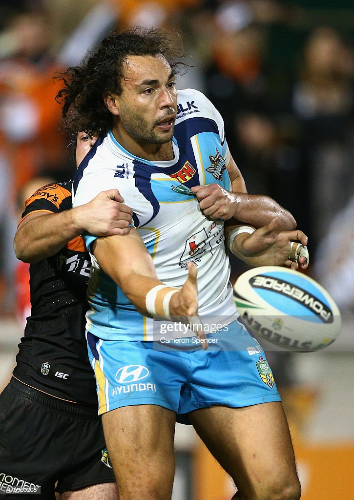 Ryan James of the Titans is tackled during the round 13 NRL match between the Wests Tigers and the Gold Coast Titans at Leichhardt Oval on June 5, 2015 in Sydney, Australia.