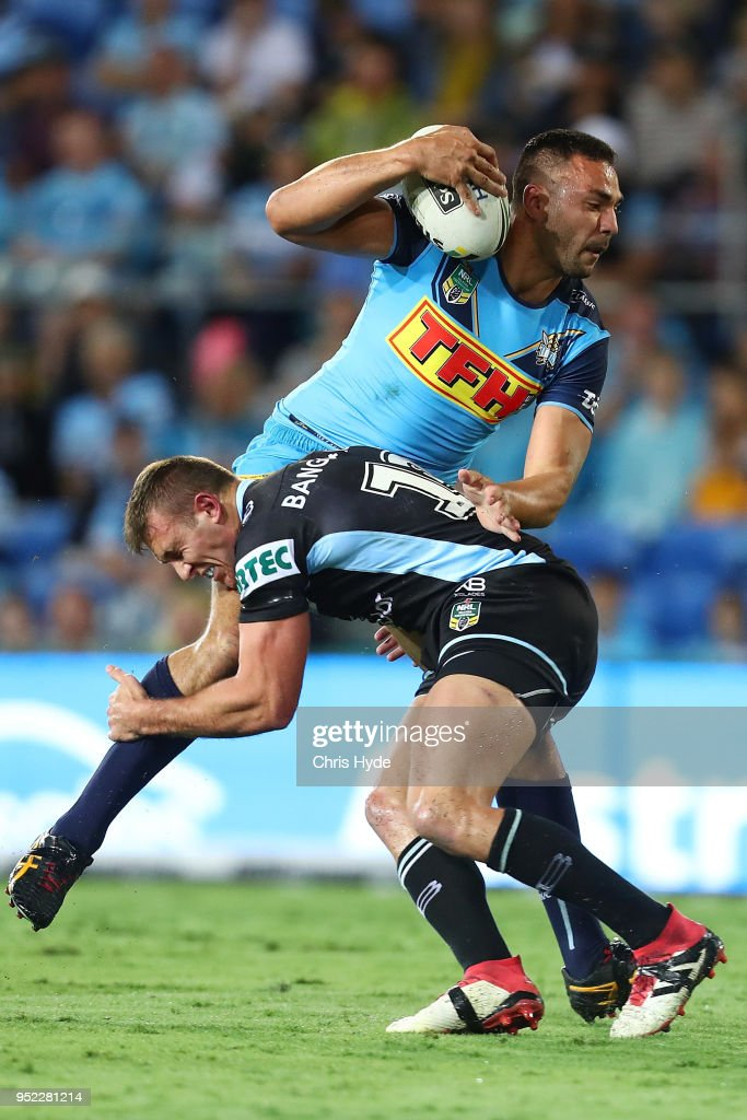 Ryan James of the Titans is tackled during the round eight NRL match between the Gold Coast Titans and Cronulla Sharks at Cbus Super Stadium on April 28, 2018 in Gold Coast, Australia.