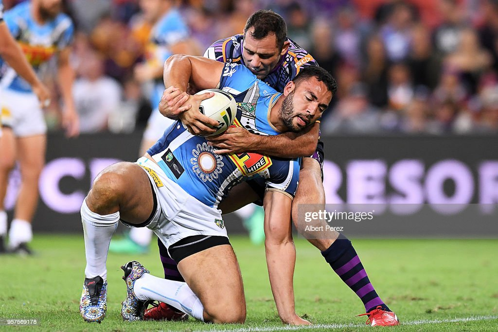 Ryan James of the Titans is tackled during the round ten NRL match between the Melbourne Storm and the Gold Coast Titans at Suncorp Stadium on May 12, 2018 in Brisbane, Australia.