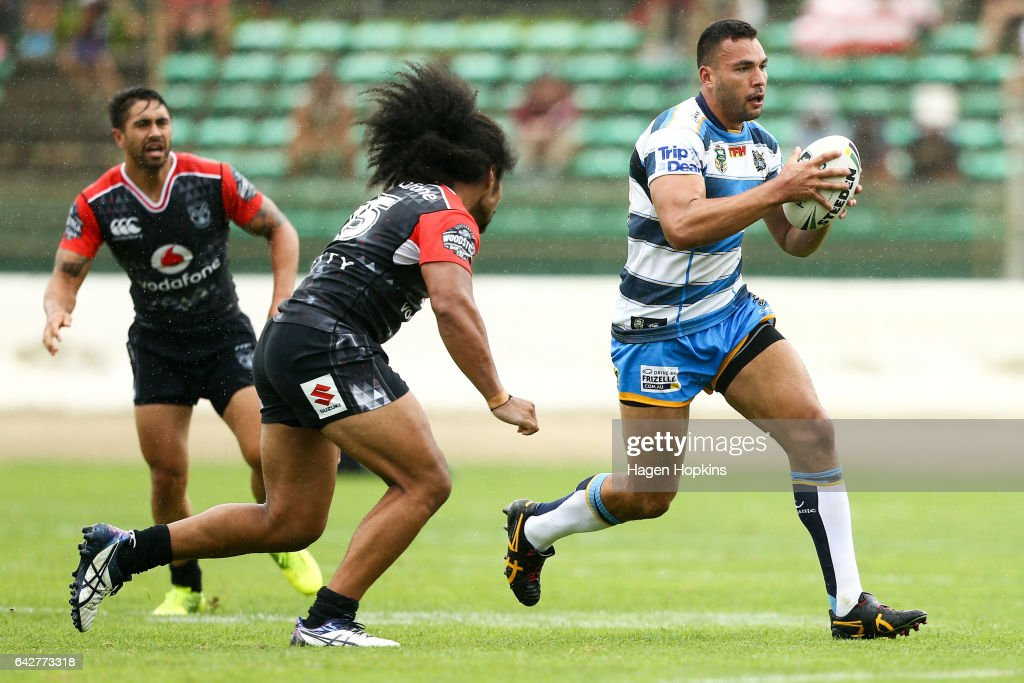 Ryan James of the Titans runs the ball under pressure from Bunty Afoa of the Warriors during the NRL Trial match between the Warriors and the Gold Coast Titans at Central Energy Trust Arena on February 19, 2017 in Palmerston North, New Zealand.
