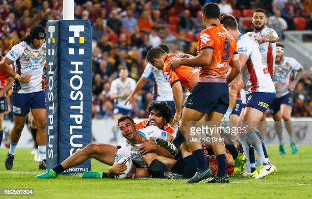 Ryan James of the Titans scores a try during the round 10 NRL match between the Melbourne Storm and the Gold Coast Titans at Suncorp Stadium on May...
