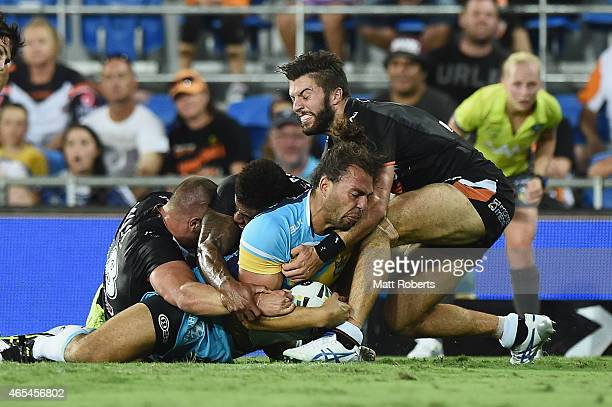 Ryan James of the Titans scores a try during the round one NRL match between the Gold Coast Titans and the Wests Tigers at Cbus Super Stadium on...