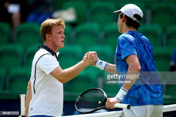 Ryan James Storrie of Great Britain shakes hands with JohnPatrick Smith of Australia after their match during day two of Qualifying of the Aegon Open...
