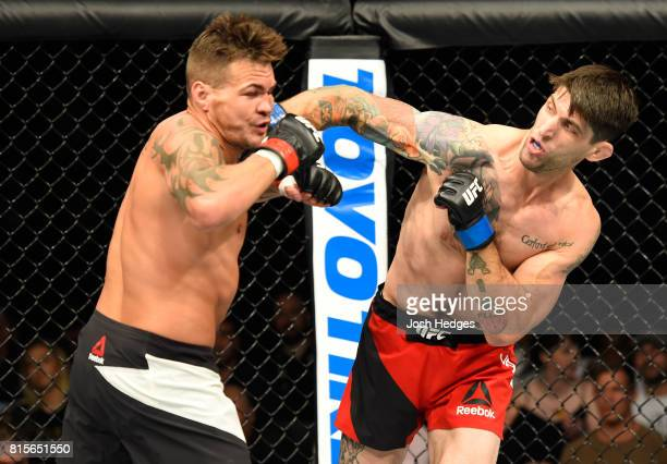 Ryan Janes of Canada punches Jack Marshman of Wales in their middleweight bout during the UFC Fight Night event at the SSE Hydro Arena Glasgow on...