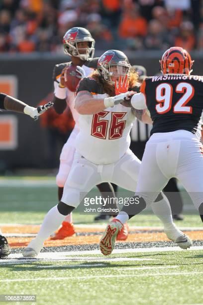 Ryan Jensen of the Tampa Bay Bucccaneers pass blocks against Adolphus Washington of the Cincinnati Bengals during their game at Paul Brown Stadium on...