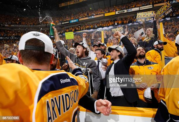Ryan Johansen and Kevin Fiala of the Nashville Predators celebrate after a 63 series win against the Anaheim Ducks in Game Six of the Western...