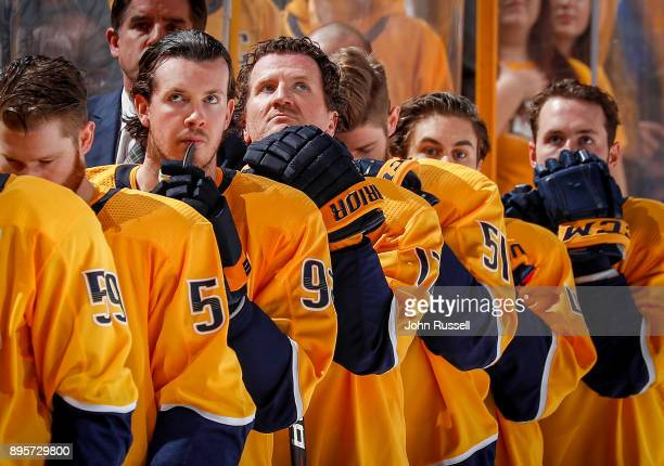 Ryan Johansen and Scott Hartnell of the Nashville Predators stand for the Canadian and US National Anthems prior to an NHL game against the Winnipeg...