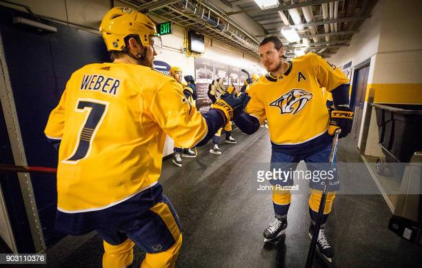 Ryan Johansen and Yannick Weber of the Nashville Predators prepare for warmups against the Edmonton Oilers prior to an NHL game at Bridgestone Arena...