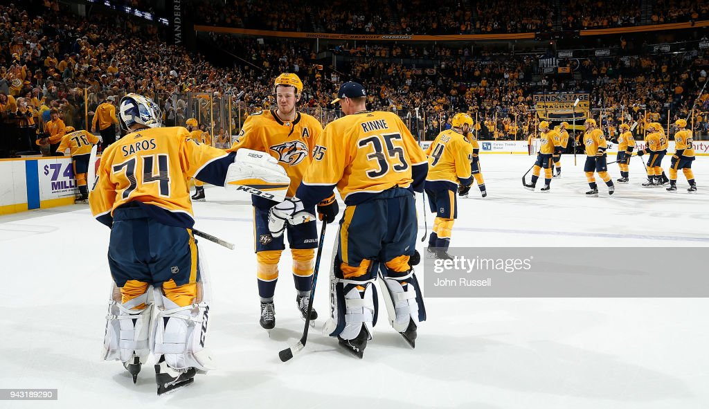 Ryan Johansen #92 celebrates a win with Juuse Saros #74 and Pekka Rinne #35 of the Nashville Predators against the Columbus Blue Jackets during an NHL game at Bridgestone Arena on April 7, 2018 in Nashville, Tennessee.