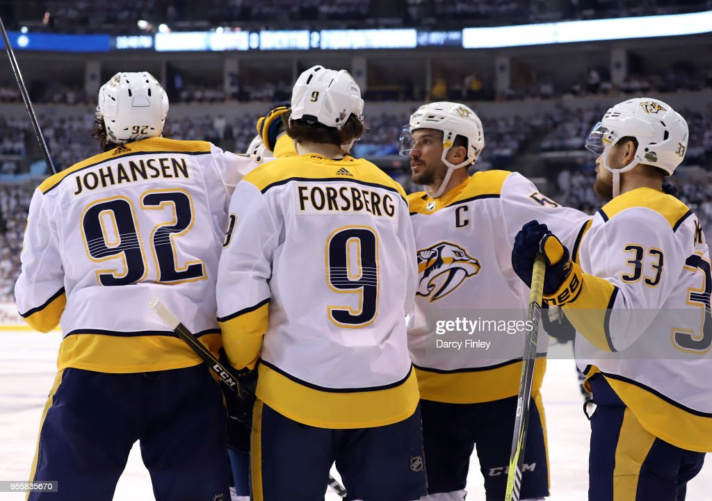 Ryan Johansen #92, Filip Forsberg #9, P.K. Subban #76, Roman Josi #59 and Viktor Arvidsson #33 of the Nashville Predators celebrate a third period goal against the Winnipeg Jets in Game Six of the Western Conference Second Round during the 2018 NHL Stanley Cup Playoffs at the Bell MTS Place on May 7, 2018 in Winnipeg, Manitoba, Canada.