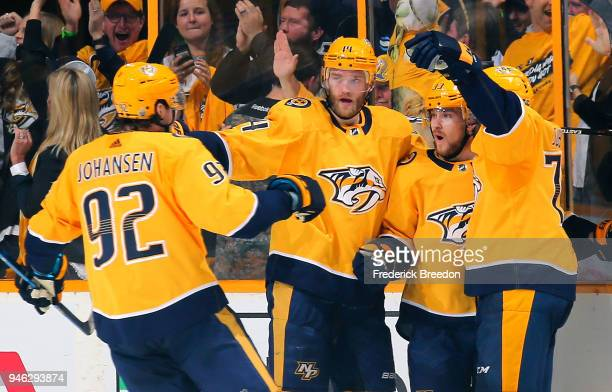 Ryan Johansen Mattias Ekholm and PK Subban of the Nashville Predators congratulate teammate Viktor Arvidsson on scoring a goal against the Colorado...