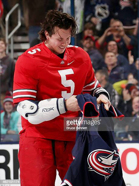 Ryan Johansen of the Columbus Blue Jackets and Team Foligno puts on his Jersey during the Honda NHL Breakaway Challenge event of the 2015 Honda NHL...