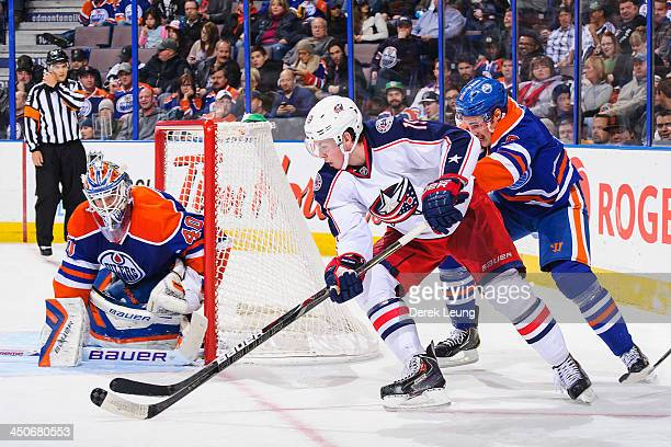 Ryan Johansen of the Columbus Blue Jackets attempts a wraparound shot on Devan Dubnyk of the Edmonton Oilers during an NHL game at Rexall Place on...