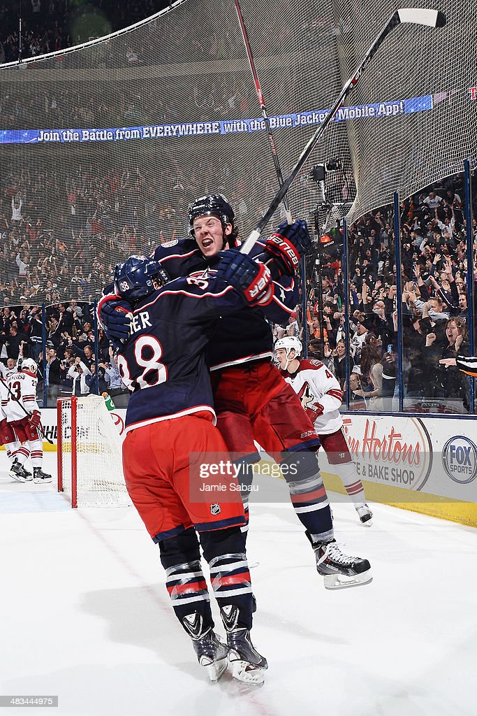Ryan Johansen #19 of the Columbus Blue Jackets celebrates his game-winning overtime goal with teammate Boone Jenner #38 in a game against the Phoenix Coyotes on April 8, 2014 at Nationwide Arena in Columbus, Ohio. Columbus defeated Phoenix 4-3 in overtime.