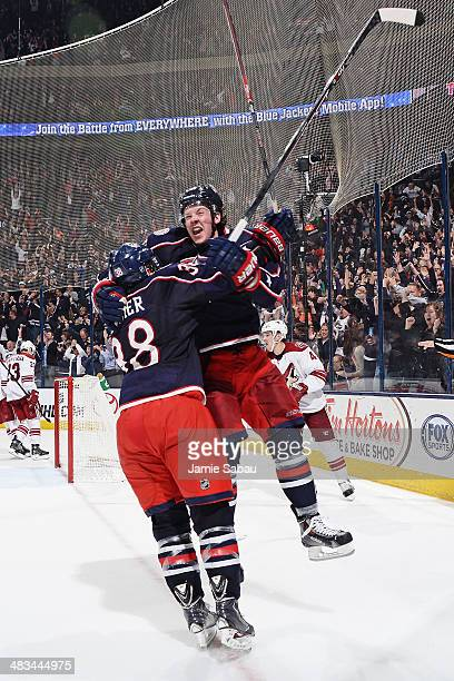 Ryan Johansen of the Columbus Blue Jackets celebrates his gamewinning overtime goal with teammate Boone Jenner in a game against the Phoenix Coyotes...