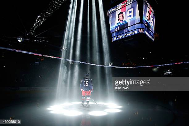 Ryan Johansen of the Columbus Blue Jackets is illuminated by spot lights while being introduced to the crowd prior to the start of the game against...