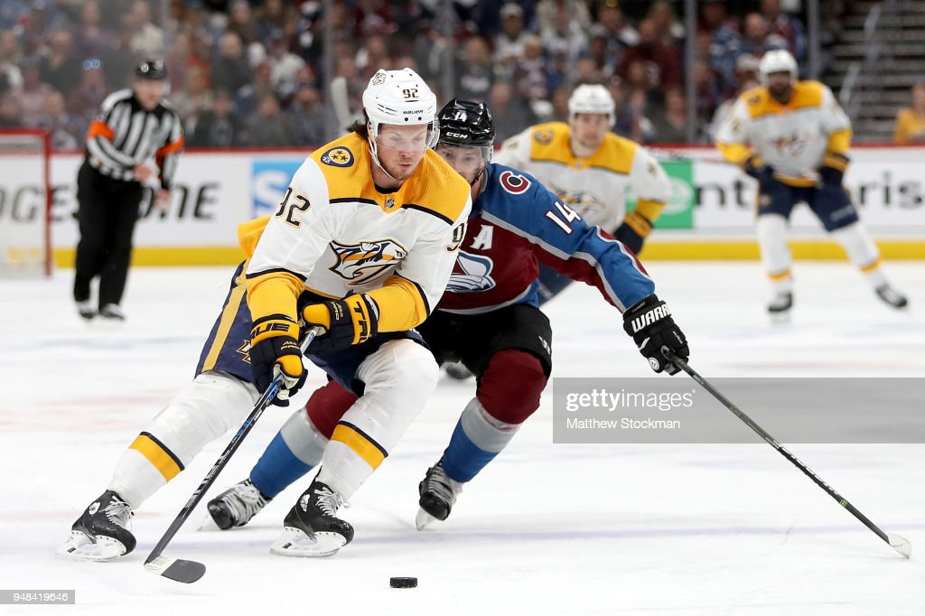Ryan Johansen #92 of the Nashville Predators advances the puck against Blake Comeau #14 of the Colorado Avalanche in Game Four of the Western Conference First Round during the 2018 NHL Stanley Cup Playoffs at the Pepsi Center on April 18, 2018 in Denver, Colorado.