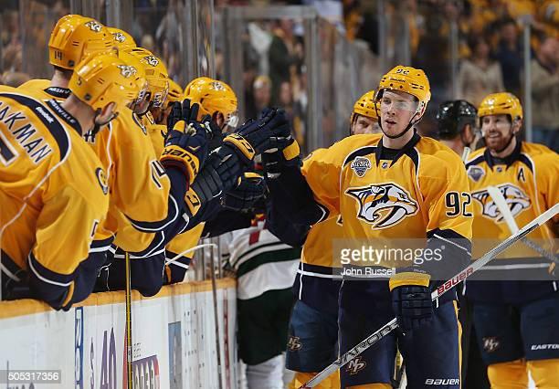 Ryan Johansen of the Nashville Predators celebrates a goal along the bench against the Minnesota Wild during an NHL game at Bridgestone Arena on...