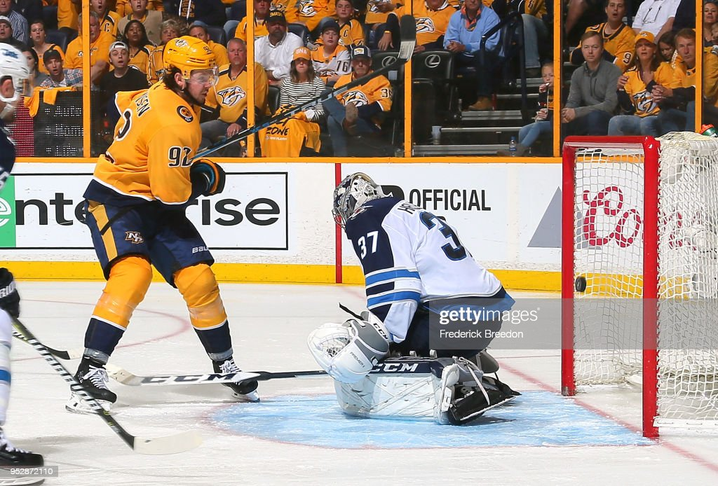 Ryan Johansen #92 of the Nashville Predators scores a goal against goalie Connor Hellebuyck #37 of the Winnipeg Jets during the third period in Game Two of the Western Conference Second Round during the 2018 NHL Stanley Cup Playoffs at Bridgestone Arena on April 29, 2018 in Nashville, Tennessee.