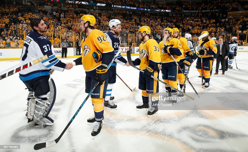 Ryan Johansen #92 of the Nashville Predators shakes hands with Connor Hellebuyck #37 of the Winnipeg Jets in Game Seven of the Western Conference Second Round during the 2018 NHL Stanley Cup Playoffs at Bridgestone Arena on May 10, 2018 in Nashville, Tennessee.
