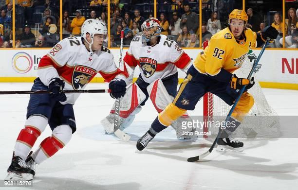 Ryan Johansen of the Nashville Predators skates against MacKenzie Weegar of the Florida Panthers during an NHL game at Bridgestone Arena on January...