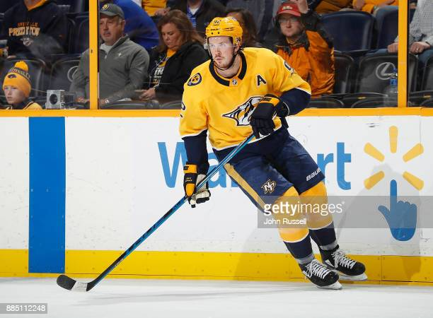 Ryan Johansen of the Nashville Predators skates against the Vancouver Canucks during an NHL game at Bridgestone Arena on November 30 2017 in...