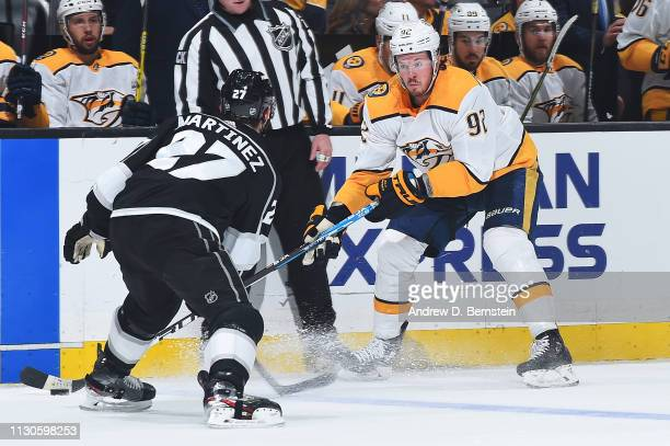 Ryan Johansen of the Nashville Predators skates with the puck with pressure from Alec Martinez of the Los Angeles Kings during the second period of...