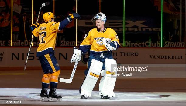 Ryan Johansen skates in to embrace Pekka Rinne of the Nashville Predators during a celebration after a 5-0 win against the Carolina Hurricanes at...