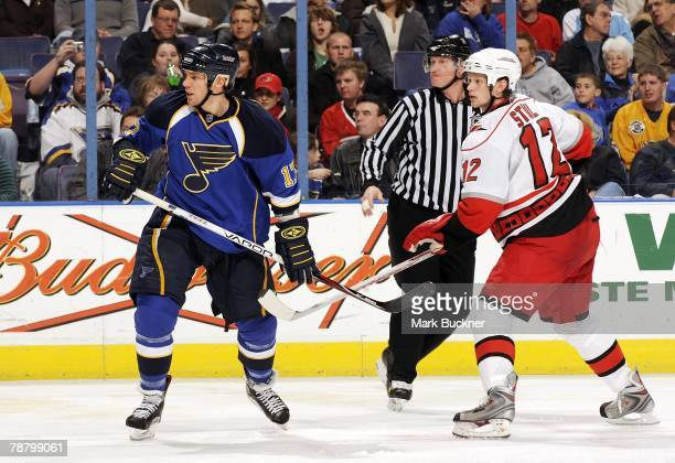 Ryan Johnson and Eric Staal of the Carolina Hurricanes keep an eye on the play in the corner on January 5 2008 at Scottrade Center in St Louis...