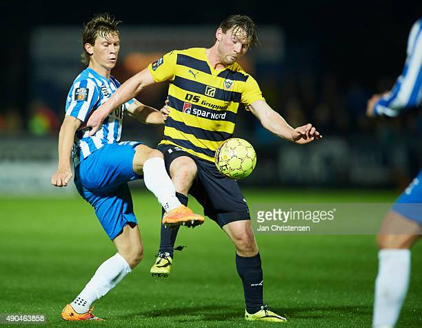 Ryan Johnson Laursen of Esbjerg fB and Pal Alexander Kirkevold of Hobro IK compete for the ball during the Danish Alka Superliga match between Hobro...