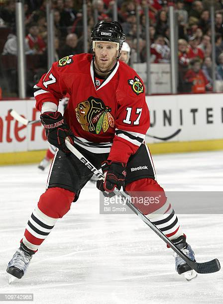 Ryan Johnson of the Chicago Blackhawks approaches the puck during the game against the Phoenix Coyotes on February 27 2011 at the United Center in...
