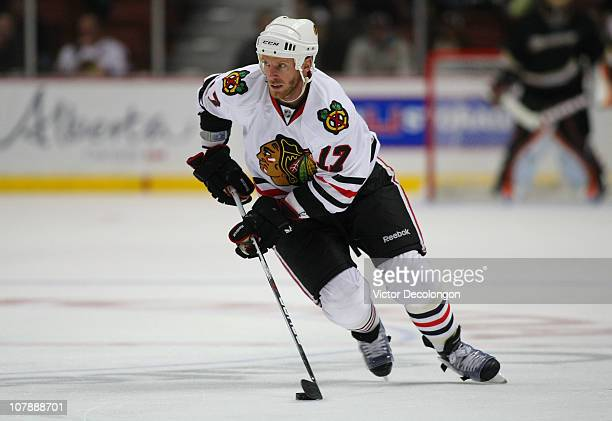 Ryan Johnson of the Chicago Blackhawks controls the puck in the neutral zone during the NHL game against the Anaheim Ducks at Honda Center on January...