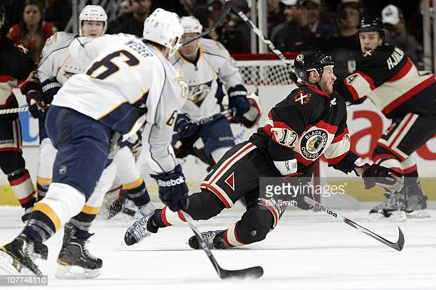 Ryan Johnson of the Chicago Blackhawks tries to block the shot taken by Shea Weber of the Nashville Predators on December 22 2010 at the United...