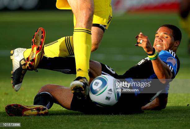Ryan Johnson of the San Jose Earthquakes battles for the ball with Chad Marshall of the Columbus Crew during an MLS game at Buck Shaw Stadium on June...