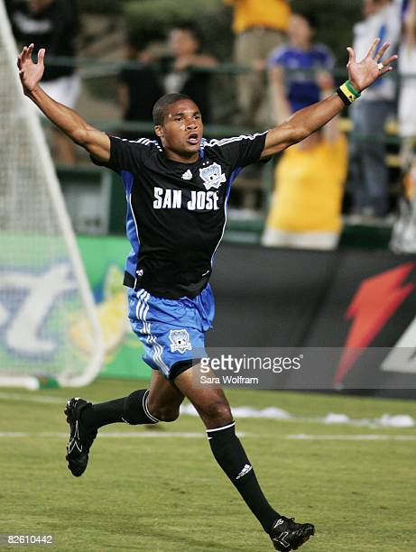 Ryan Johnson of the San Jose Earthquakes celebrates after assisting on a goal scored by Darren Huckerby during the MLS game against the New England...