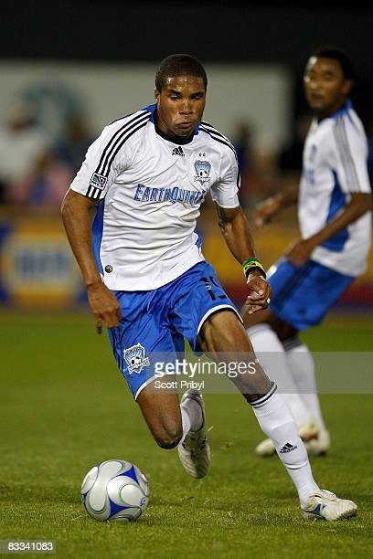 Ryan Johnson of the San Jose Earthquakes dribbles the ball against the Kansas City Wizards during the game at Community America Ballpark on October...