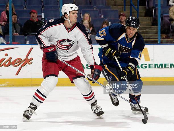 Ryan Johnson of the St Louis Blues battles Ron Hainsey of the Columbus Blue Jackets for position February 17 2008 at Scottrade Center in St Louis...
