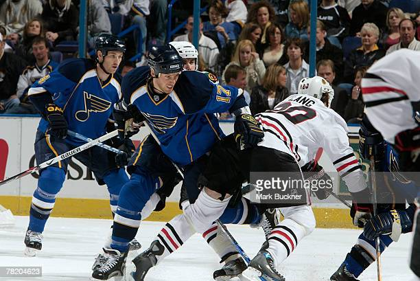 Ryan Johnson of the St Louis Blues checks Robert Lang of the Chicago Blackhawks on December 1 2007 at Scottrade Center in St Louis Missouri