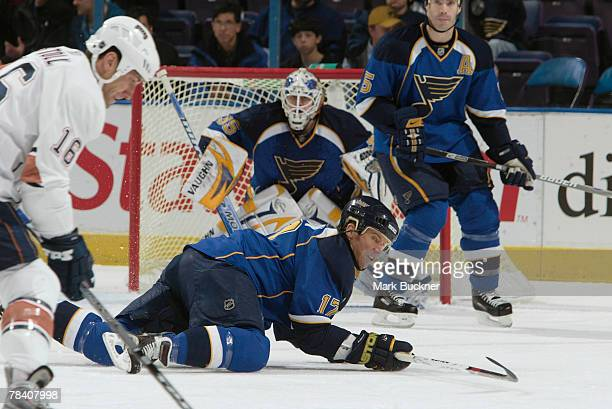 Ryan Johnson of the St Louis Blues drops to the ice to block a shot by Jarret Stoll of the Edmonton Oilers on December 11 2007 at Scottrade Center in...