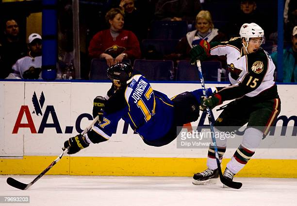 Ryan Johnson of the St Louis Blues is checked by James Sheppard of the Minnesota Wild at the Scottrade Center February 10 2008 in St Louis Missouri