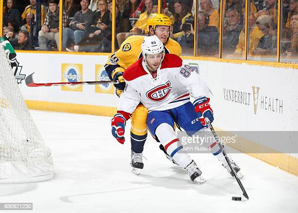 Ryan Johnston of the Montreal Canadiens skates against Colton Sissons of the Nashville Predators during an NHL game at Bridgestone Arena on January 3...