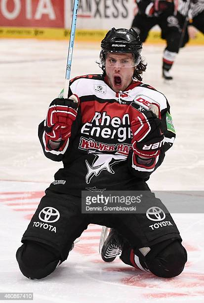 Ryan Jones of Koelner Haie celebrates as he scores the opening goal during the DEL Ice Hockey game between Koelner Haie and EHC Red Bull Muenchen at...