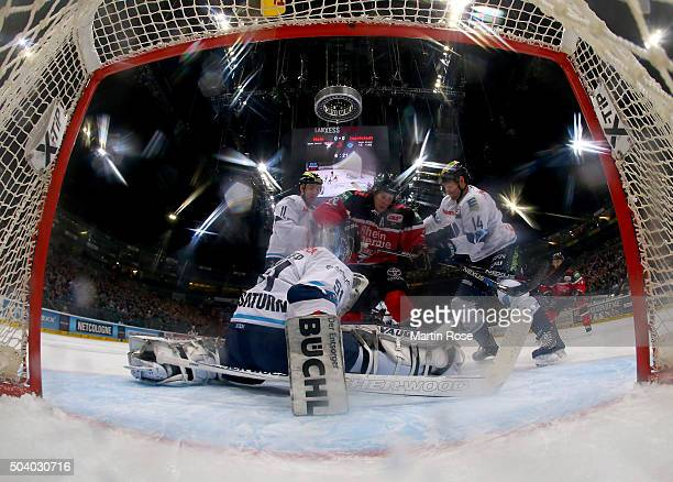Ryan Jones of Koelner Haie fails to score over Timo Pielmeier goaltender of ERC Ingolstadt during the DEL Ice Hockey match between Koelner Haie and...