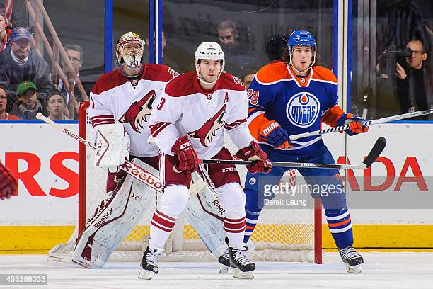 Ryan Jones of the Edmonton Oilers looks for an opportunity as Keith Yandle and Mike Smith of the Phoenix Coyotes defend net during an NHL game at...